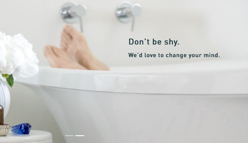 Person in a bathtub with text, Don't be shy, we'd love to change your mind!